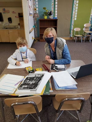 Amber Yarnell, ELL teacher at Wooster City Schools, works on-on-one with Leandro Wiesner Soto, a first-grader at Melrose Elementary School, on Thursday, Nov. 19. Leandro's mother is from Mexico, and his father is from Switzerland, so he speaks Spanish and Swiss-German.