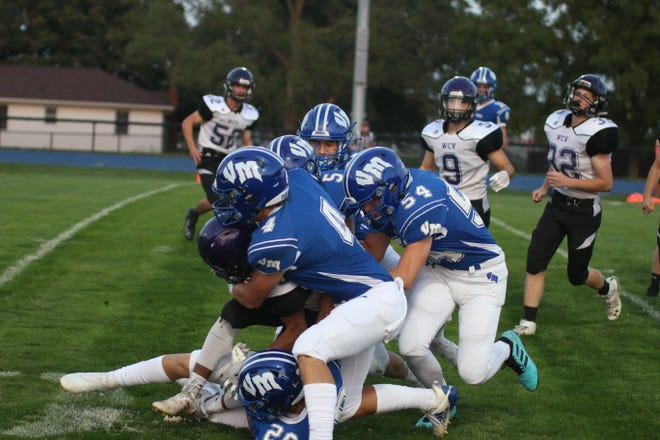 The Van Meter defense stopping the West Central Valley runner on Friday, Sept. 18 at home.