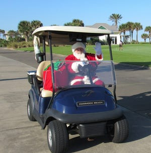 Santa takes a brief break to play golf before getting busy in December.