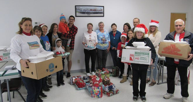 Flagler Mayor Linda Provencher (in white sweatshirt) also helped deliver meals and toys at Christmas in 2019.