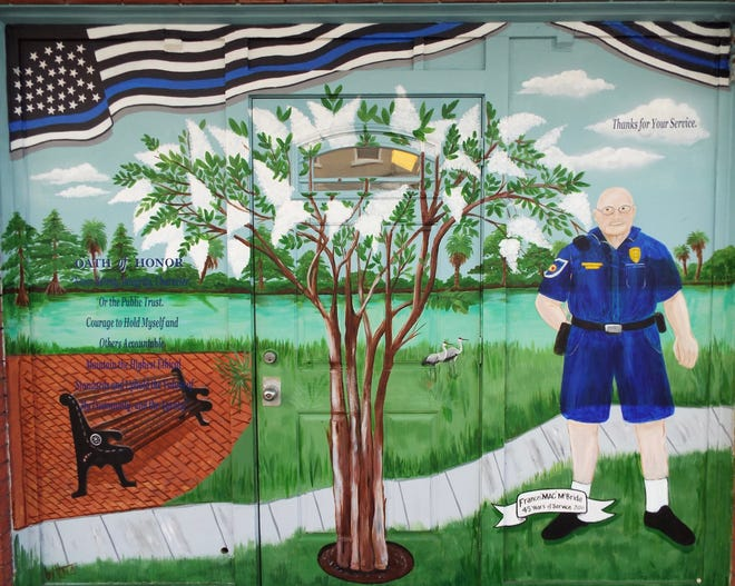 The owner of Dick and Jane's Cafe in downtown DeLand had this mural painted on a wall of his business as a sign of appreciation for longtime policeman, Francis McBride, who retired after 45 years of foot patrols in the center of town.