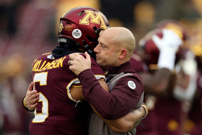 Minnesota head coach P.J. Fleck hugs defensive back Chris Williamson during an NCAA college football game in 2019. Fleck has never lacked for clever ways to connect and motivate his players.