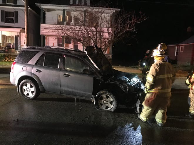 The 18-year-old male driver of this SUV was uninjured when his vehicle caught fire after colliding with a parked car Wednesday night in the 900 block of East Eighth Street in Erie.
