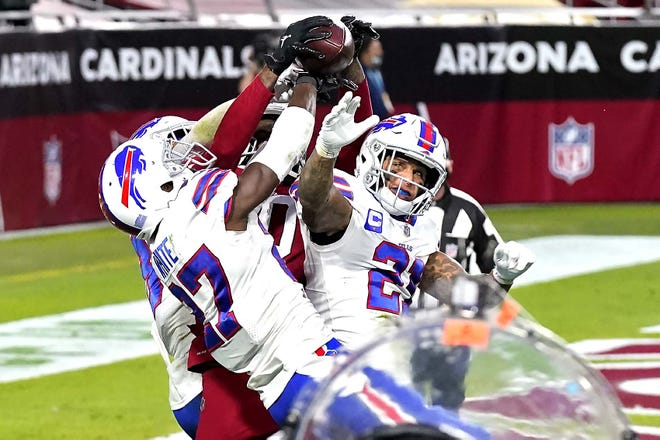 Arizona Cardinals wide receiver DeAndre Hopkins catches the game-winning touchdown as Buffalo Bills Tre'Davious White (27), Jordan Poyer (21) and Micah Hyde defend at teh end of Sunday's game in Glendale, Arizona. The Cardinals won 32-30.