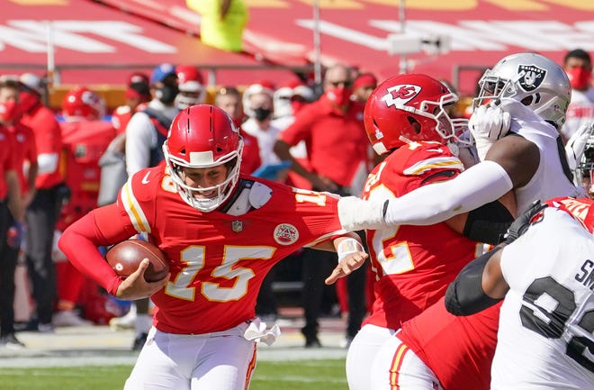 Kansas City Chiefs quarterback Patrick Mahomes (15) is held back by Las Vegas Raiders defensive tackle Maliek Collins during their game at Arrowhead Stadium on Oct. 11. The Raiders won that game 40-32, the Chiefs' only loss so far, and reportedly took a victory lap around the stadium in their bus. The Chiefs are seeking revenge Sunday in their first trip to Las Vegas.