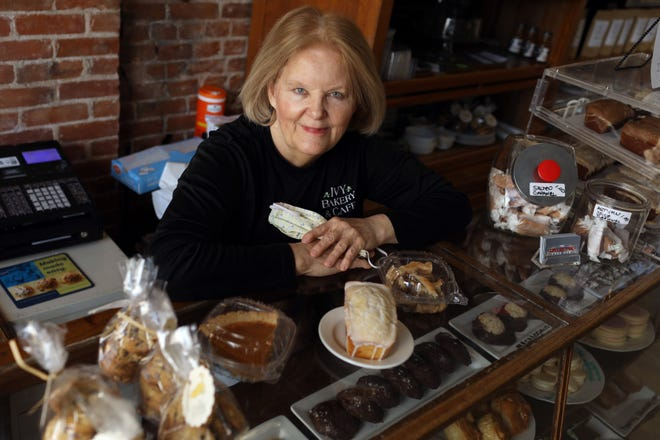 Chef and restauranteur Martha Wolf is shown Thursday next to some individual desserts at the The Collective Food Hub in downtown Burlington. The year's traditional Thanksgiving may look different, with many people skipping large family gatherings and opting for more smaller affairs.