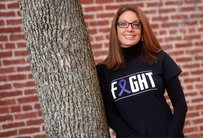Kelly Glennon, co-owner of Jewelry Creations in downtown Dover, lost her father to pancreatic cancer in 2010 and has been raising money to help fund research since that time.