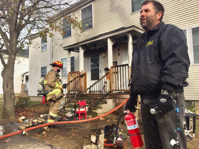 Ed Brown saw a porch fire at the Gosling Meadows neighborhood in Portsmouth and doused most of it Thursday with an extinguisher.