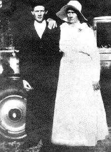 """Melton """"Doll Baby"""" Crews, 22,  is shown with his new bride, Lydia Stone, 64, on their wedding day. The new Chevrolet she bought for the occasion can be seen in the background."""