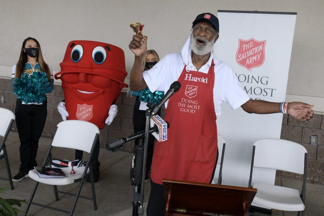 """Harold Pierce, a long-time Jacksonville bell ringer for The Salvation Army, wraps up Thursday's kickoff event by singing """"It's Beginning to Look a Lot Like Christmas"""" outside the Publix grocery at the Roosevelt Mall."""