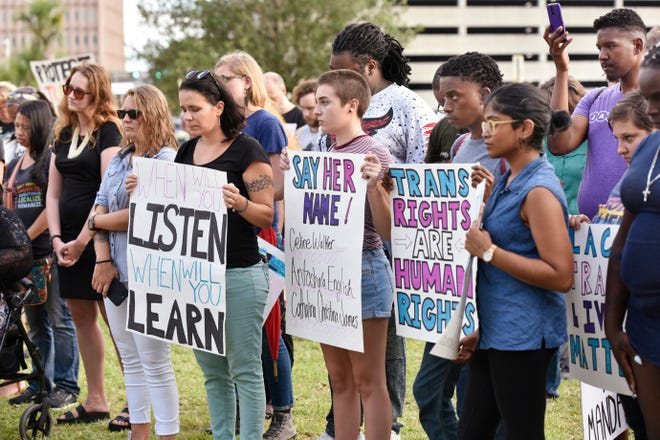 Supporters of the local transgender community rally outside the Duval County Courthouse the third shooting death of a transgender woman in Jacksonville in 2018. Friday is a national Transgender Day of Remembrance.