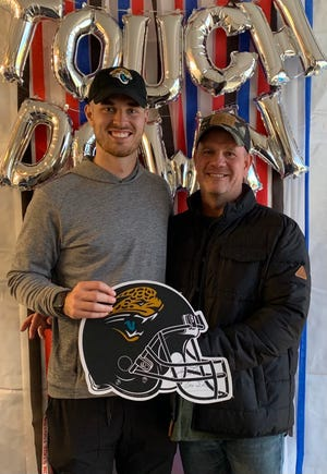 Jaguars quarterback Jake Luton (left) is understandably proud of his father Judd (right), who has been a paramedic for more than 20 years.