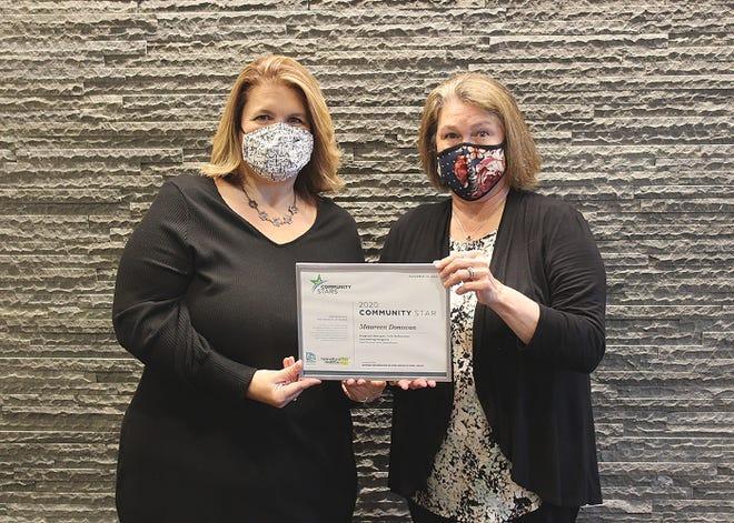Heywood Healthcare's School Based Community Health Worker Christina Cutting presents Maureen Donovan with her Community Star award.