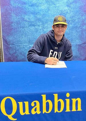 Quabbin senior Gavin Price signs his National Letter of Intent to play Division 1 baseball at Fairleigh-Dickinson University during a brief signing ceremony at Quabbin Regional High School on Thursday, Nov. 12, 2020.
