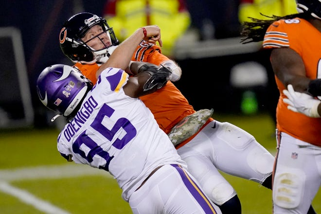 Chicago Bears quarterback Nick Foles tries to throw under pressure from Minnesota Vikings defensive end Ifeadi Odenigbo (95) during the second half of Monday's game in Chicago. Foles was injured on the play and left the game. [AP Photo/Charles Rex Arbogast]
