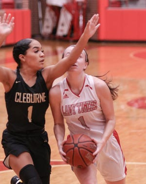 Glen Rose's Hazel Hawkins takes an elbow to the chin while driving to the basket against Cleburne on Friday.