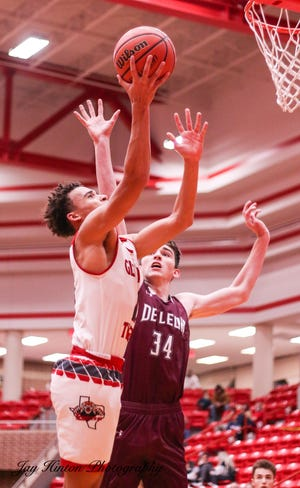 Glen Rose's Caden Smith takes the ball hard to the basket against DeLeon on Tuesday.