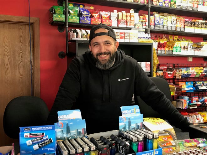"Rakan ""Rocky"" Madanat stands behind the counter of his Rocky's Market on Nov. 18, 2020. He just opened the store at 1500 NE Jefferson St."