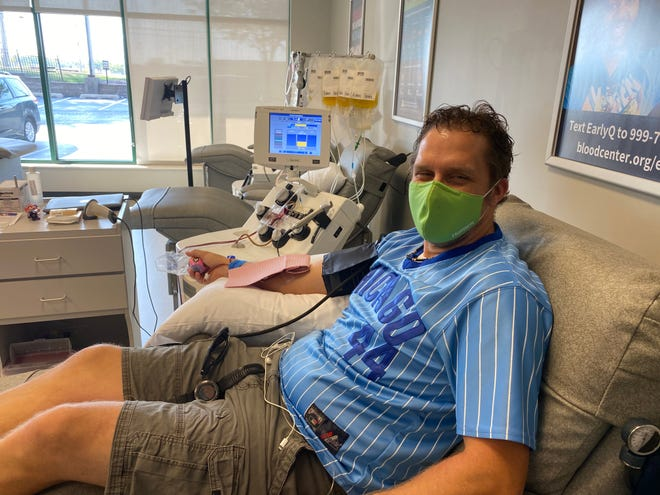 Matt Briggs donates plasma at the Mississippi Valley Regional Blood Center in Peoria. Briggs has donated convalescent plasma multiple times since being diagnosed with COVID-19 in late July.