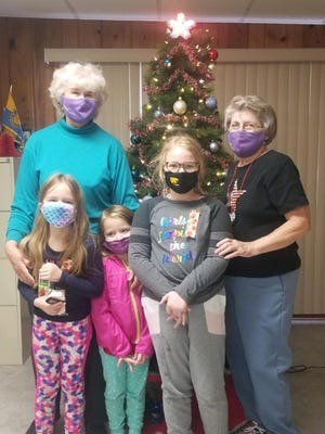 The Lena American Legion recently put up its Christmas tree for the 2020 holiday season. Pictured, back: Judy Oellerich. Front, from left: Marsha Tessendorf, Kinzley Schulz, Kairi Schulz and Keighlyn Schulz