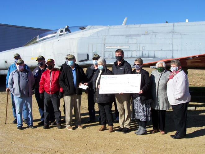 The Realtor Association of Northwestern Illinois presents a check to the Northwest Illinois Aerial Combat Memorial committee Tuesday, Nov. 17, 2020, at Rafters Restaurant in Lena.