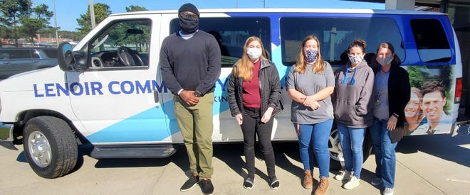 From left, Principal Rodney McNeill, seniors Allison Pate and Marybeth McMillion, Administrative Assistant Tracey Beaman and LCC Liaison Sharon King loaded the 918 food items for Mary's kitchen. [CONTRIBUTED PHOTO]