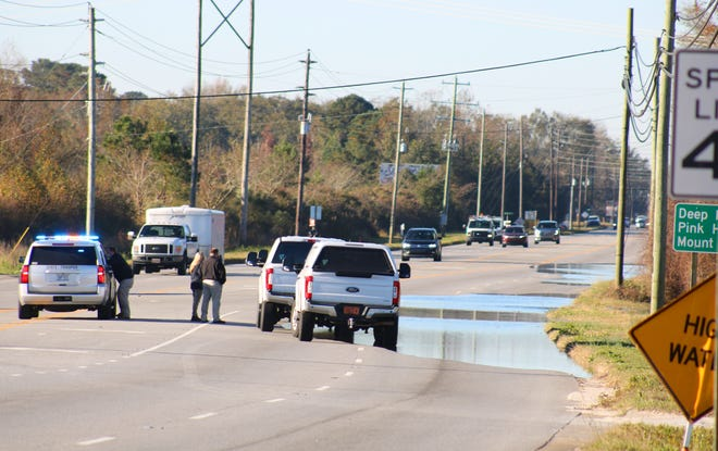 Lenoir County Emergency officials block the southbound lane of Hwy. 11 near Skinner's Bypass Thursday, November 19, due to flooding.