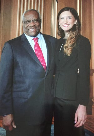 Kathryn Kimball Mizelle is shown with U.S. Supreme Court Justice Clarence Thomas, for whom she clerked, in this undated photo. Thomas is set to perform the swearing-in ceremony as the newest federal judge on the United States District Court for the Middle District of Florida for the Lakeland native on Nov. 25 in Washington, D.C.