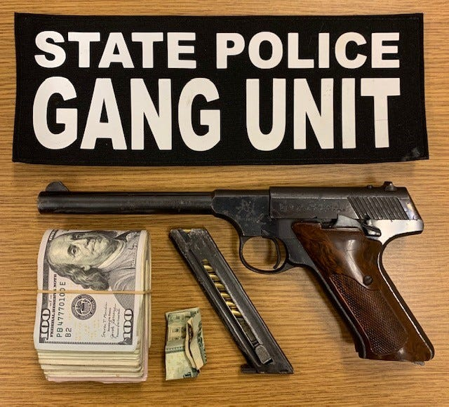 The $1,400 in cash, Colt pistol and ammunition that State Police troopers said they found during the arrest of three people, including two reputed Worcester gang members, at The Mall at Whitney Field in Leominster on Tuesday.
