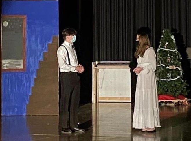 """Macomb High School seniors Eli Sperry (left) and Gracie Jones (right) rehearse on the set of, """"It's a Wonderful Life."""""""