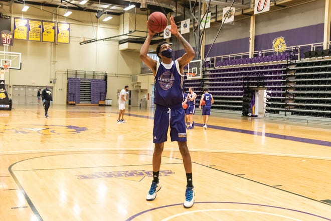 A member of the Western Illinois basketball team goes up for a shot during a practice earlier this fall.