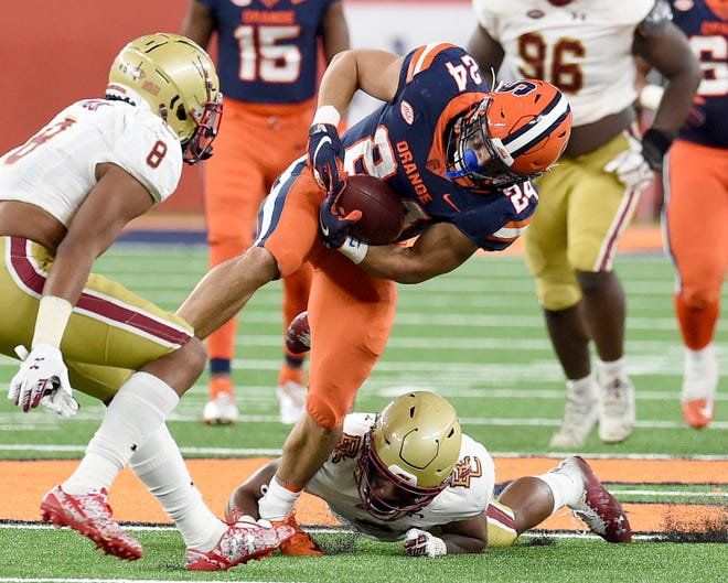 Running back Cooper Lutz (24) and the Syracuse football team are coming off a bye aiming to halt a five-game losing streak.
