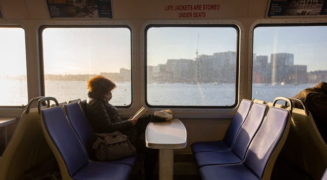 Cathy Murray, of Hull, reading on the ferry from Hull into Boston. She takes the ferry to work every day.