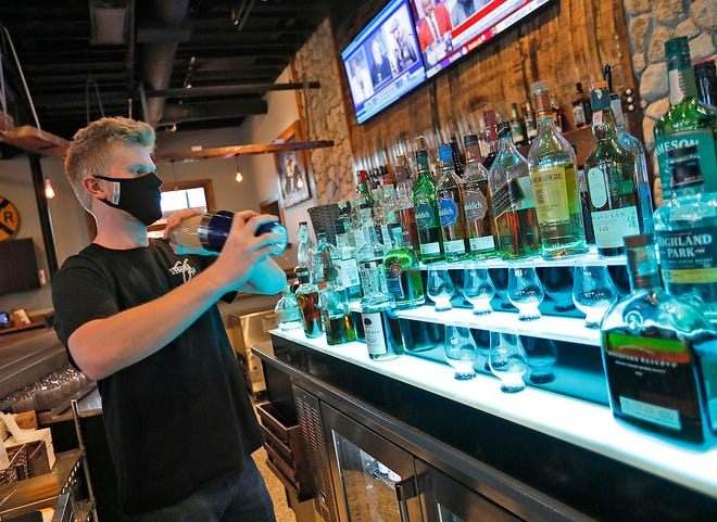 Bartender Chris Anderson mixes a drink at Station Eight in Marshfield.