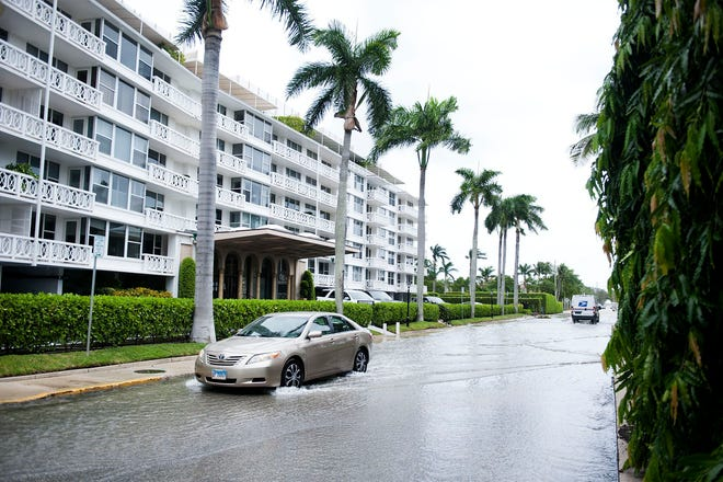 Rain and the end of the king tides in September caused the Intracoastal Waterway to spill into Sunset Avenue.