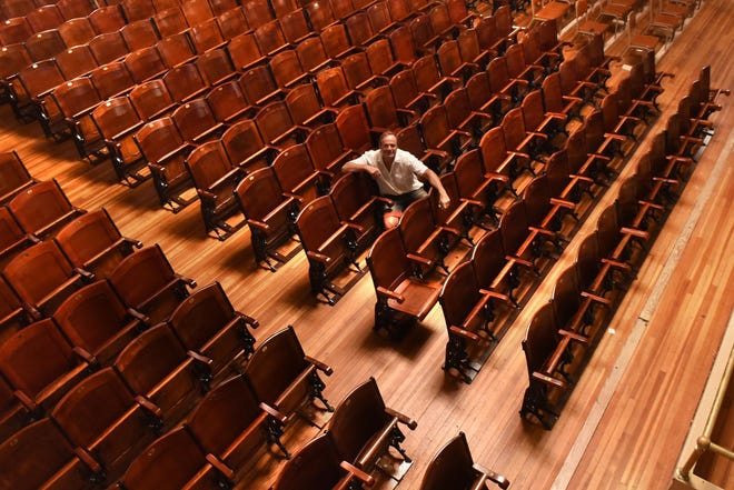 Anthony Ejarque, executive director of the Rochester Opera House, sits in the audience seating ahead of the theater reopening in August 2020 after being closed due to COVID-19. He announced this week the venue was canceling its already shortened winter season out of renewed COVID-19 concerns.
