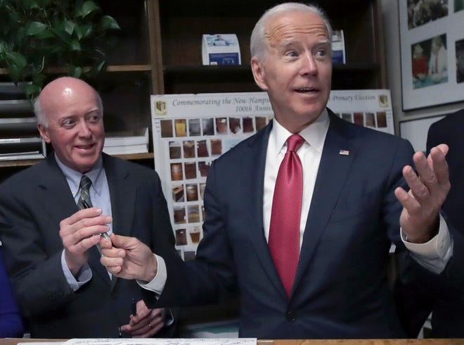 n this Nov. 8, 2019, photo, then Democratic presidential candidate former Vice President Joe Biden hands the pen to New Hampshire Secretary of State Bill Gardner, left, after filing to have his name listed on the New Hampshire primary ballot, in Concord.