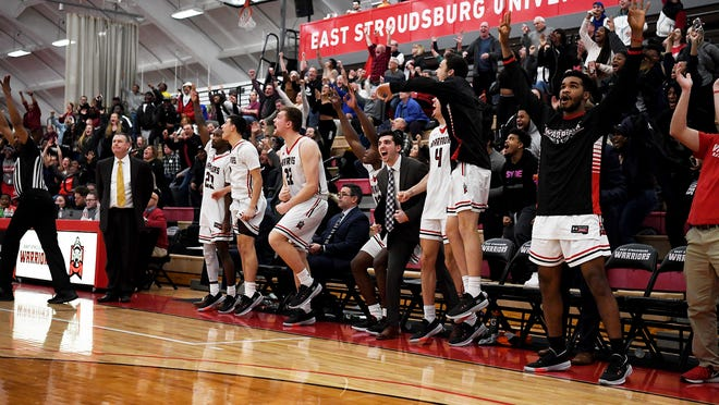 The East Stroudsburg University men's basketball team celebrates against Kutztown on Wednesday, Feb. 12, 2020. The Warriors will not have a formal PSAC 2020-21 season after the conference canceled winter sports Wednesday.