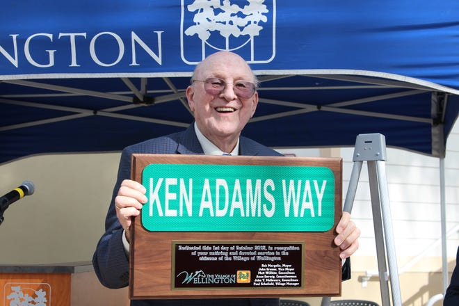 Wellington founder Ken Adams had a street named in his honor in October 2015 by the Village Council. The street runs near the community center, amphitheater, Village Hall, pool and Lake Wellington Professional Centre.
