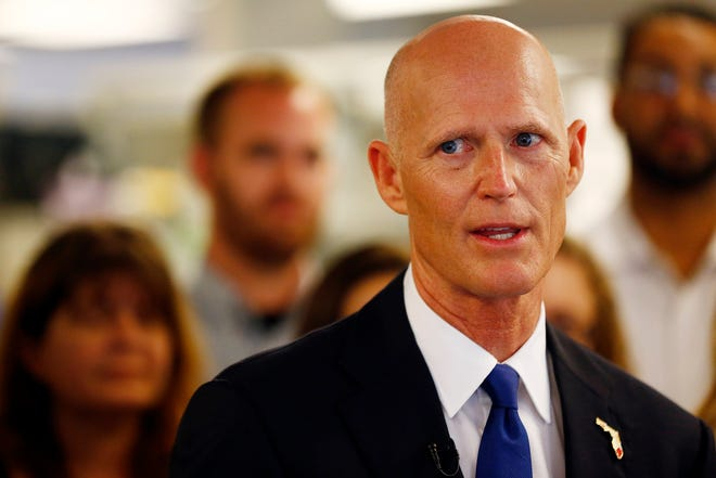 Florida Sen. Rick Scott has supported President Donald Trump's efforts to fight the presidential election results.  [Corey Perrine/Naples Daily News via AP]
