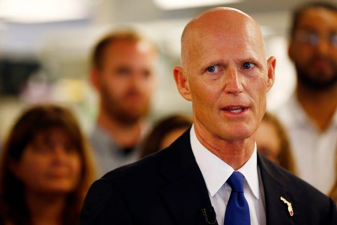 Florida Sen. Rick Scott [Corey Perrine/Naples Daily News via AP]
