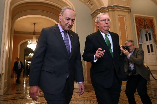 WASHINGTON -- From left, current Senate Minority Leader Charles Schumer (D-NY) and Senate Majority Leader Mitch McConnell (R-KY) walk side-by-side to the Senate Chamber at the U.S. Capitol. [Chip Somodevilla/Getty Images/TNS]