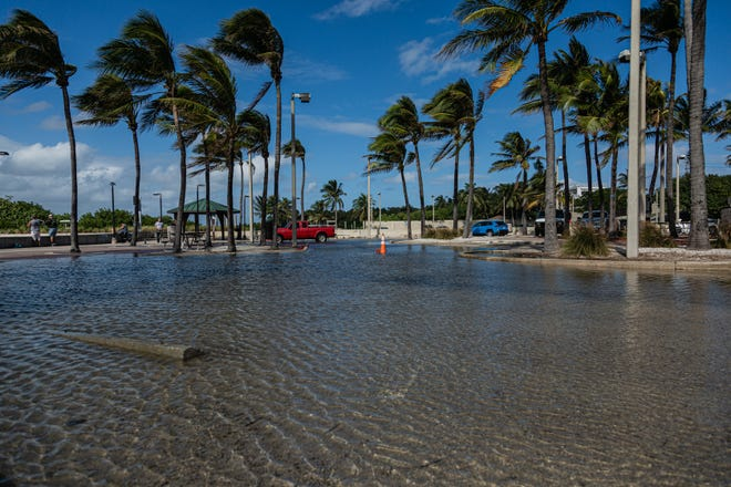Flooding in the parking lot of the Boynton Inlet due to high tides, Nov. 19.