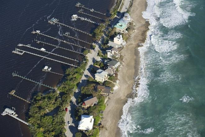 Aerial view of homes on Macarthur Boulevard between the Indian River Lagoon and the Atlantic Ocean on Hutchinson Island in Stuart.