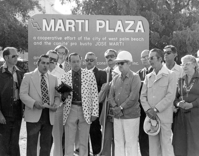 "At the April 5, 1976, ground-breaking for José Martí Park, Armando Acosta (second from left) reads a proclamation honoring the ""Apostle of Cuban Liberty."" Nine Cuban organizations, including the Pro-Cuba Association and the Latin Chamber of Commerce, cooperated with the City of West Palm Beach on the project. The Latin Chamber of Commerce - now the Hispanic Chamber of Commerce of Palm Beach County - has about 400 members. Among those attending the ceremony is West Palm Beach Mayor James Adams (fifth from left). José Martí Park, on North Flagler Drive between Second and Third streets, is sometimes used to hold rallies and as a staging point for marches."