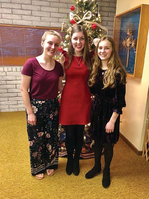 Allison Kirby (left), Kahrie Stegman (middle) and Grace May (right) pose for a picture after performing in Pratt Musical Expressions concert December of 2019. [File photo]