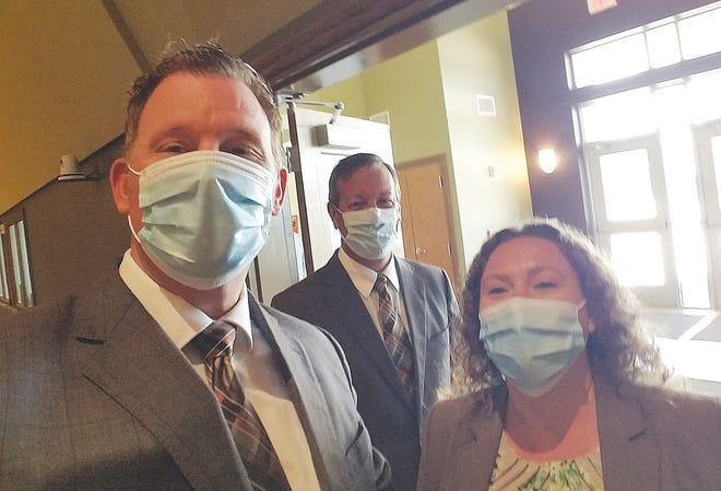 Eric Larrison, Jarrod Bishop and Willow Navarro serve the public at Larrison Mortuary in Pratt.