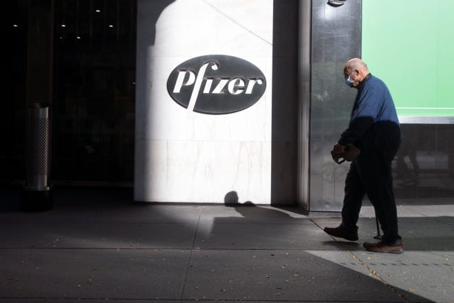 Pedestrians pass by the Pfizer world headquarters in New York last week.