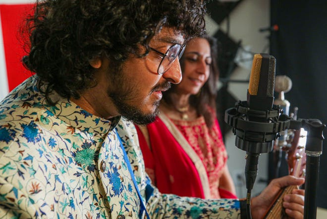 Dhruvit Shah, left, and Sumita Gokhale will perform several songs in the Indian Association of Rhode Island's virtual Diwali celebration. [The Providence Journal / David DelPoio]