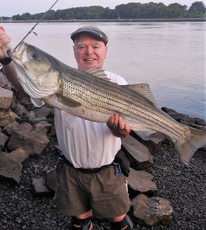 Cape Cod Canal striped bass fishing expert